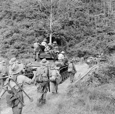 French; As the combined forces of GM 5 & GCP 8 retire down route RC 4 at the end of Operation Hirondelle some of the retiring infantrymen cadge a ride aboard the M24 Chaffe tanks. July '53