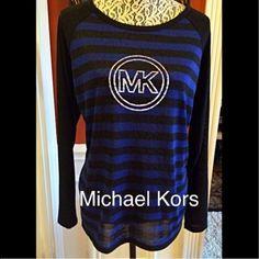 Michaels Kors Top Michaels Kors lightweight sweater. Silver stud MK emblem. Dark Azurite navy stripe. Back is solid lack. Worn only a few times. 95% polyester , 5% spandex. Michael Kors Tops