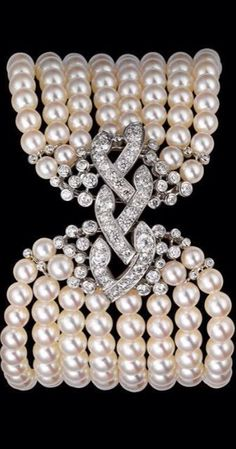 Diamond, Pearl and Platinum bracelet by Cartier.