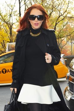 "We are obsessed with ""Liz & Dick"" star Lindsay Lohan in these over-sized square sunnies with temple detailing. They look great with her almost all-black ensemble with white color blocking."