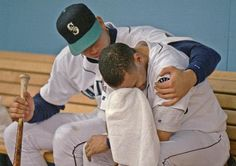 Seattle Mariners' Alex Rodriguez, left, consoles teammate Joey Cora in the Mariners' dugout following the team's loss to the Cleveland Indians in Seattle on Oct. 17, 1995. The Indians won 4-0 to clinch the American League championship series. I just don't see A-Rod doing something like this today.