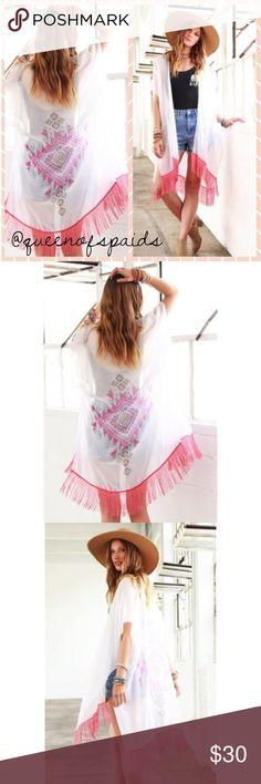 Pink & White Aztec Pattern Print Kimono Elegant simple aztecs printed pattern with contrast. Fine threads fringe accent.   65% Polyester 35% Viscose 32.5 x 31.5 Swim Coverups