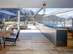 Unique architecture in Kitzbühel with enormous outdoor area with an extralarge swimming pool.