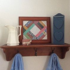 Decorating the bathroom with a framed quilt block made by Sharon Theriault