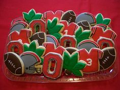 Ohio State (OSU) Football Cookies - it's pretty much against my religion but someone I respect very much would like them Buckeye Cookies, Football Cookies, Buckeyes Football, Ohio State Football, Ohio State Buckeyes, Ohio State Michigan, Ohio State University, Ohio State Cake, Michigan Game