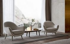 Mad Queen armchair with external covering and Mad Coffee Table small table in black elm and mat calacatta oro Marble.