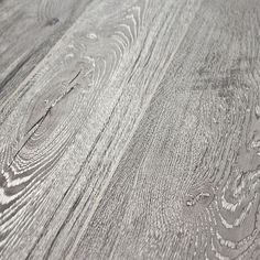 """Okay, so maybe I'm losing my mind, but I think I might be enamored with gray laminate flooring. I was all """"walnut, walnut, walnut,"""" but the tides of my brain are turning, my friends. They are a-turning."""