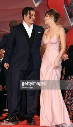 Johnny Depp and Dakota Johnson attend a premiere for 'Black Mass' during the 72nd Venice Film Festival on September 4, 2015 in Venice, Italy.