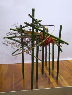 Last week I had intended to mention that the Sogetsu installation at the Melbourne International Flower and Garden Show could be thought o. Ikebana Arrangements, Ikebana Flower Arrangement, Floral Arrangements, Bamboo Poles, Bamboo Fence, Dutch Iris, Sogetsu Ikebana, Organic Structure, Christmas Window Display