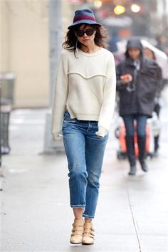 Just call her Plain Jane! Katie Holmes easily blended in with the crowd in distressed denim and a cream sweater, which she paired with a hat and booties, during a stroll in New York on April 8, 2014.