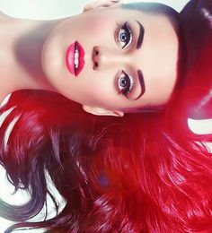 Katy Perry has a great voice, and sense of humor. Plus, look at her hair and make-up; very fun! :)