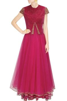 Introducing a fuchsia layered anarkali in net fabric with printed yoke.This fuchsia layered anarkali has front open coat in textured velvet with zardozi and a