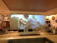 An installation of a Rear Projection Film at an FCUK store in London