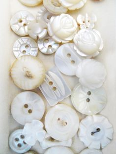 Lovely assortment of vintage MOP buttons from Laurie at Button Floozies.
