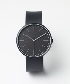 104 SERIES PVD Black / Black Rubber by Uniform Wares. The 104/KK-01 reference is inspired by the uncluttered, straightforward design and utilitarian functionality of mid-century British factory wall clocks. This design features a more subtle play with tonal colour hues and texture.