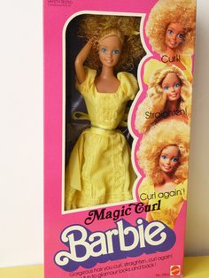 magic curl barbie.  I had this one and ruined her hair.   She will forever have an afro