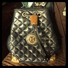 FLASH SALEMETROCITY di Baccialini  Authentic Quilted Navy Leather Vintage METROCITY di Braccialini mini backpack Crossbody. Authenticity number 7188. Purchased and Made in Italy. Rare size and model. Highly coveted in Europe. Solid brass hardware. Leather lining in pristine condition. SMOKE FREE METROCITY di Braccialini Bags Backpacks