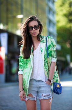 green blazer + ripped denim shorts