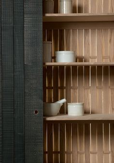 Woven coppiced beech is used for the back panel of this freestanding cabinet. I love this effect. I am visualising barn door style sliding panels to screen my balconies