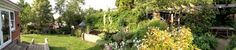 A panoramic view of some of our garden. Garden room on the left and then greenhouse, pond, studio and entertaining area.