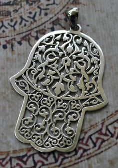Morocco | Hand of Fatima / Khamsa pendant; sterling silver | 39$