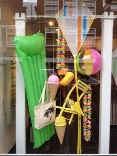 Summer window display at optic store. Styled and created by Rich Art Design, The Netherlands.
