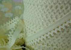 "$1.35 1/2"" cream stretch elastic with an interesting edge. Cream colored"