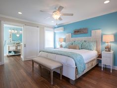 A shade of vivid sky blue draws the eye in the master bedroom, where a king-sized bed, custom-built from old and new lumber, provides a focal point.