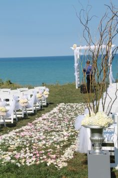beautiful lake setting aisle covered with ivory white pink rose petals chair