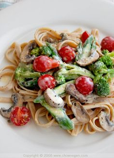 Vegetable Fettuccine Alfredo (made with tofu, its not your typical alfredo sauce!) by chow vegan.. cant wait to try it!