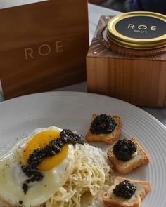 Breakfast lunch or dinner? Cacio e pepe with a sunny side up egg this simple pasta is made with just pepper parmesan reggiano butter and a dollop of ROE.