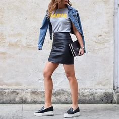 Proof That a Leather Skirt Is the Most Versatile Piece a Woman Can Own With a Denim Jacket, Graphic T-Shirt, and Platform Slip-Ons