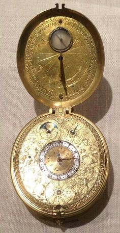 Gilt brass watch with sundial, ca. 1605, from the collection of Metropolitan Museum of Art.  I want.