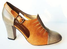 A smart, late 1920's / early 1930's style high heel pump with open sides and vamp perforations. - Leather uppers with leather soles - Whole and half sizes, 5 ½-11 (Runs big; order a half size smaller)