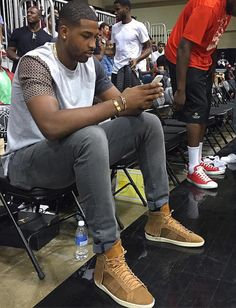 Tristan Thompson Court-side Wearing Saint Laurent Fringed Sneakers at OVO Bounce in Toronto Givenchy Boots, Balenciaga Jacket, Givenchy Shirt, Saint Laurent Shirt, Saint Laurent Sneakers, Khloe Kardashian Boyfriend Tristan, Thom Browne Suit, Vetements Hoodie, Tom Ford Jacket
