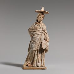 Terracotta statuette of a woman,hellenistic period,3rd century BC    Greek.