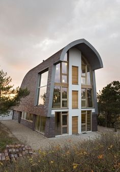 Dune House measures a total of 350 sq m (3,767 sq ft), spread over three floors (Photo: Er...
