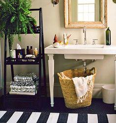 black & white bathroom & striped rug. (Domino)