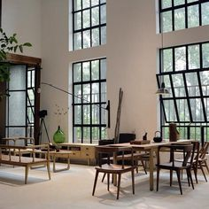 Industrial windows and lights, white walls, tall roof, big door frames, plants, perfect...