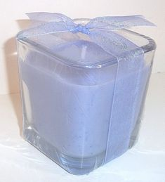 """This Lavender cube candle is ready to fill your home with a clean, light, floral scent. This is truly a lavender fragrance like no other. Mmmmm.....fresh lavender......the purest, cleanest floral fragrance around!  These cute cube jars are 3"""" h x 2.75"""" d and are shrink wrapped to contain the fragrance until you're ready to burn the candle! Topped with a ribbon, the candle make a gift all on its own!  $8.49"""