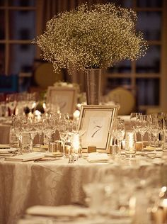Round tables – Fill the center of the table with a single vignette that showcases something unique at each direction; Using one large flower arrangement is a classic choice here.