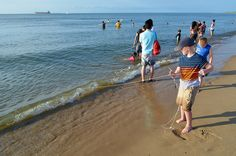 Rangers are on the beach to help teach  visitors how to use crab lines. First Landing State Park, Virginia offers crabbing programs all summer long