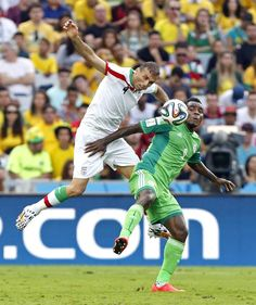 Iran's Jalal Hosseini heads the ball past Nigeria's Emmanuel Emenike during the group F World Cup soccer match between Iran and Nigeria at t. World Cup Groups, Soccer Match, World Cup 2014, Iran, Baseball Cards, Sports, People, Hs Sports, Sport
