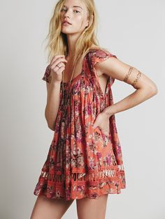 at Free People Short Sleeve Deep V Printed Tunic in coral combo