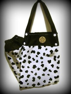 Store your Plastic Grocery Bags in this great cow print bag holder!