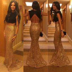 Imagem de http://g01.a.alicdn.com/kf/HTB1IUAVJVXXXXc4XXXXq6xXFXXX3/Hot-Sale-Two-Pieces-Long-Prom-Dress-Vestidos-Black-Top-Gold-Skirt-with-Sequins-Crop-Top.jpg.