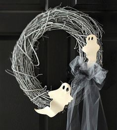 Spray paint a grapevine wreath and add Sculpy Ghosts