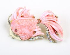 This brooch is not signed but is attributed to Hattie Carnegie and is featured in the book unsigned beauties. This fun brooch is a pale coral or shrimp colour with white marbling through the lucite. | eBay!