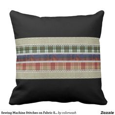 """Sewing Machine Stitches on Fabric Strips Pillow - The fabric strips sewn together with a variety of machine stitches give the sense of old-fashioned """"hearth and home,"""" while the high-contrast black background gives this throw pillow a thoroughly modern feel. It's the best of both worlds. #pillows #sewing"""