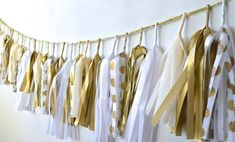 Polka Dot Gold, White, Ivory Sparkle & Shine Tissue Tassel Garland. $49.00, via Etsy.
